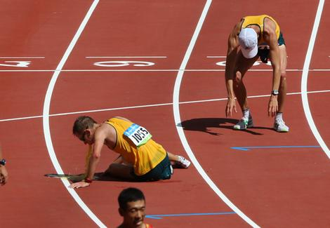 Another Aussie athlete has a chunder after losing race whilst fellow Aussie prepares to take a dump